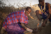 While out there in the bush and far away from any source of fire, Maasai men will make fire by rubbing two pieces of wood together. Once smoke starts coming out due to the friction created by rubbing the two sticks together, they sprinkle some fine donkey dung on the small hole and turn it into ember after blowing into the hole gently.