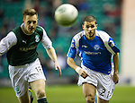 Hibs v St Johnstone.....11.02.13      SPL.Mehdi Abeid chases the ball down with Alan Maybury.Picture by Graeme Hart..Copyright Perthshire Picture Agency.Tel: 01738 623350  Mobile: 07990 594431