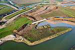 Nederland, Noord-Brabant, Werkendam, 28-10-2014; Ruimte voor de Rivier project Ontpoldering Noordwaard. Overzicht grondwerk t.b.v. de aanleg van meanderende kreken, inclusief nieuwe bruggen.<br /> De Noordwaard wordt ontpolderd door de dijken aan de rivierzijde gedeeltelijk af te graven, hierdoor kan derivier bij hoogwater via de Noordwaard sneller naar zee stromen. Gevolg van de ingrepen is ook dat de waterstand verder stroomopwaarts zal dalen.<br /> National Project Ruimte voor de Rivier (Room for the River) By lowering and / or moving the dike of the Noordwaard polder the area will become subject to controlled inundation and function as a dedicated water detention district. Houses and farmhouses will be constructed on new dwelling mounds. <br /> luchtfoto (toeslag op standard tarieven);<br /> aerial photo (additional fee required);<br /> copyright foto/photo Siebe Swart