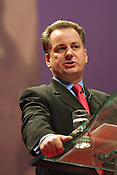 Jack McConnell speaks at the Labour Party conference, held in Glasgow, Scotland, on 15th February 2003. The same day massive anti-Iraq war peace protests were held throughout Britain, with the general public opposing the imminent invasion of Iraq.