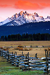 Sawtooth Mountains- Mt. Williams in the Sawtooth National Recreation Area at sunrise with the historic wood fencing.