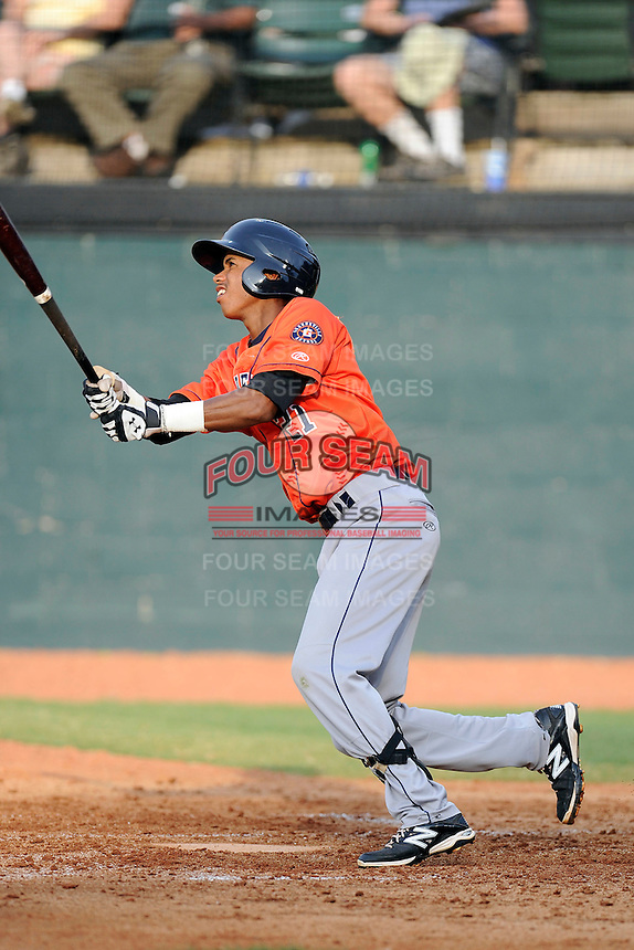 Shortstop Jeffry Santos (21) of the Greeneville Astros bats in a game against the Bristol Pirates on Saturday, July 26, 2014, at DeVault Memorial Stadium in Bristol, Virginia. Greeneville won, 2-1 in Game 1 of a doubleheader. (Tom Priddy/Four Seam Images)