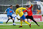 UCD v St Johnstone...10.07.11  Pre-season Friendly.Stevie May fires past UCD keeper Gerard Barron to make it 3-0.Picture by Graeme Hart..Copyright Perthshire Picture Agency.Tel: 01738 623350  Mobile: 07990 594431