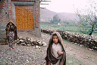 Two childs next to a Buddhist Stupa in the Swat valley in Pakistan. .Taxila, the main centre of Gandhara, is over 3,000 years old. Taxila had attracted Alexander the great from Macedonia in 326 BC, with whom the influence of Greek culture came to this part of the world. Taxila later came under the Mauryan dynasty and reached a remarkable matured level of development under the great Ashoka. During the year 2 BC, Buddhism was adopted as the state religion, which flourished and prevailed for over 1,000 years, until the year 10 AD. During this time Taxila, Swat and Charsadda (old Pushkalavati) became three important centers for culture, trade and learning. Hundreds of monasteries and stupas were built together with Greek and Kushan towns such as Sirkap and Sirsukh, both in Taxila.