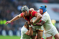 Jonathan Davies of Wales is double tackled by Jonathan Joseph and Jack Nowell of England. RBS Six Nations match between England and Wales on March 12, 2016 at Twickenham Stadium in London, England. Photo by: Patrick Khachfe / Onside Images