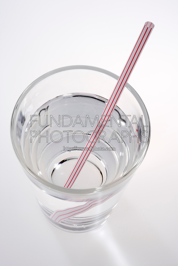 REFRACTION OF LIGHT - STRAW IN GLASS OF WATER (2 of 2)<br /> Refraction When Straw Enters Water at an Angle<br /> Light rays passing from one medium to another are refracted at the boundary between the two media. However when the object is viewed as a perpendicular to the boundary point, in this case from above, no refraction is observable.
