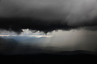 A storm builds as the clouds back up against the dividing range of the mountains at Kurilskoe Lake Preserve.   i