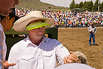 Riding a saddle bronc blindfolded is an old and traditional way for some cowboys at the Jordan Valley Big Loop Rodeo in Ore.