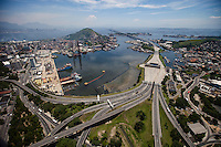Border of Guanabara Bay at Niteroi city, showing the Rio-Niteroi bridge ( Praca do pedagio / toll square in the center ) . The bay has been heavily impacted by urbanization, deforestation, and pollution of its waters with sewage, garbage, and oil spills.