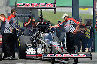 May 19, 2012; Topeka, KS, USA: NHRA crew members for top fuel dragster driver Steve Torrence during qualifying for the Summer Nationals at Heartland Park Topeka. Mandatory Credit: Mark J. Rebilas-
