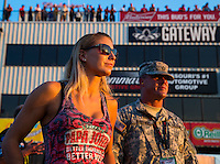 Sep 23, 2016; Madison, IL, USA; NHRA driver Leah Pritchett, pilot of the Papa Johns Pizza sponsored top fuel dragster of Don Schumacher Racing stands alongside a US Army soldier during qualifying for the Midwest Nationals at Gateway Motorsports Park. Mandatory Credit: Mark J. Rebilas-USA TODAY Sports
