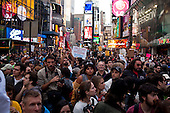New York, New York<br /> October 15, 2011<br /> <br /> As anger toward financial institutions spread around the world &quot;Occupy Wall Street&quot; took their protest to New  York City's Times Square as the movement went global with demonstrations in major cities around the world. <br /> <br /> The protest, that began on September 17, is primarily  protesting against social and economic inequality, corporate greed, and the influence of corporate money and lobbyists on government, among other concerns.