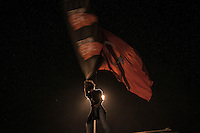 In this Saturday, Jun. 08, 2013 photo, a protester waves a flag inTaksim Square during a 24/7 masive rally against the turkish government in Istanbul, Turkey. (Photo/Narciso Contreras).