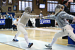 12 February 2017: UNC's Meredith Bozentka (left) and Duke's Lindsay Sapienza (right) during Saber. The Duke University Blue Devils hosted the University of North Carolina Tar Heels at Card Gym in Durham, North Carolina in a 2017 College Women's Fencing match. Duke won the dual match 14-13 overall and 7-2 in Epee. UNC won Foil 6-3 and Saber 5-4.
