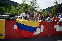 Colombian race fans wait at the end of stage 6 for their hero (who was 2nd overall at that time), Juan Mauricio Soler.  Unfortunately, they soon learned that Soler would not be arriving because of a terrible crash mid-stage--leaving him with a fractured skull and broken leg.