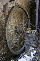 "Switzerland. Canton Ticino. Aranno forge. The ""Sentiero delle Meraviglie"" is a walking path. Water as a source of energy has been used since antiquity, with the water mill as perhaps the best-know application. Its use, however, in driving a forge, is much less common. Metal wheel and stone walls. The ""Sentiero delle Meraviglie"" is a guided trail which is plunged into nature, but every so often signs of human activity appear. Aranno is located in the Malcantone area. 16.03.2010 © 2010 Didier Ruef"