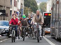 King Philippe, Queen Mathilde of Belgium & kids bicycling in Brussels - Belgium