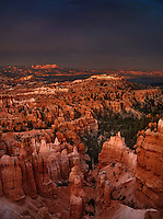 730750049 evening light casts a warm glow on the silent city hoodoos in a clearing monsoon summer storm seen from sunset point at bryce canyon national park utah