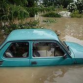 NOWY WIONCZENIN, POLAND, MAY 24, 2010:.Flooded Fiat 126 car..The latest chapter of disastrous floods in Poland has been opened yesterday, May 23, 2010, after Vistula river broke its banks and flooded over 25 villages causing evacualtion of most inhabitants..Photo by Piotr Malecki / Napo Images..NOWY WIONCZENIN, POLSKA, 24/05/2010:.Zatopiony fiat 126p.  Najnowszy akt straszliwych tegorocznych powodzi zostal rozpoczety wczoraj gdy Wisla przerwala waly na wysokosci wsi Swiniary kolo Plocka..Fot: Piotr Malecki / Napo Images ..