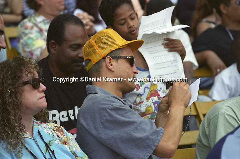 Actor Woody Harrelson signs autographs on March 28, 1999 as the Baltimore Orioles of Major League Baseball defeated the Cuban national baseball team at the Estadio Latinoamericano in Havana, Cuba in the first of two exhibition games played between the two teams. This game marked the first time that a MLB team played in Cuba since 1959.