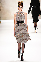 Agnete Hegelund walks runway in a Monique Lhuillier Fall 2011 outfit, during Mercedes-Benz Fashion Week Fall 2011.