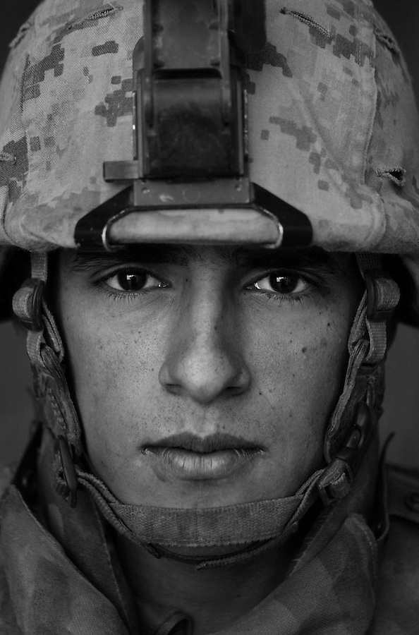 Lcpl. Jaime Angulo, 19, Holland, Michigan, Weapons Platoon, Kilo Co., 3rd Battalion 1st Marines, 1st Marine Division, United States Marine Corps, at the company's firm base in Haditha, Iraq on Sunday Oct. 22, 2005.