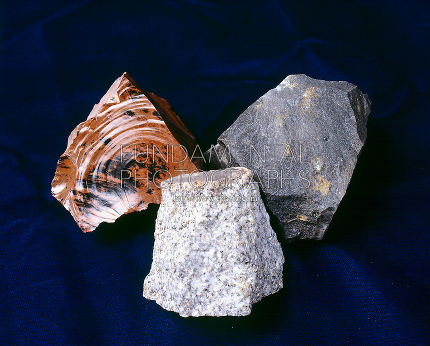 IGNEOUS ROCKS - Obsidian; Basalt; Granite<br /> Left: Obsidian -red, glassy; Center: Granite -dark gray, coarse grained, plutonic; Right: Basalt- extrusive, volcanic.