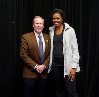 First Lady Michelle Obama stands with Kevin Payne,  US Soccer Foundation board member and President and CEO of DC United, during a US Soccer Foundation clinic held at City Center in Washington, DC.