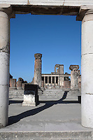 Basilica, Pompeii, 2nd century BC. Located on the South West side of the Forum it is one of the oldest remaining examples of a Roman Basilica. Seen through the Colonnade, are the remains of some of the many Ionic columns which lined the building and supported the roof