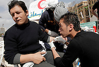 A man is having shotgun pellets removed from his arm by volunteer doctors in Tahrir square, after the revolution that saw president Hosni Mubarak ousted from office. Some protesters still occupied the Tahrir Square until March 9, when they were chased away by armed men,  while life in other parts of the city returned to normal.