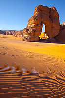 Big Arch and dunes, Jebel Acacus, LIbya, Mountains in Sahara Desert UNESCO World Heritage Site