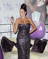 Amy Childs.The photocall to launch her debut fragrance in collaboration with Jigsaw, Aura bar & nightclub, London, England..August 15th, 2012.half length purple strapless dress  sequins sequined hair up bun hand on hip looking down.CAP/CAN.©Can Nguyen/Capital Pictures.