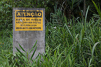 Warning sign against eating fruit or drinking water in the jungle due to pollution from the factories, Cubatão