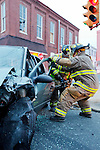 Clifton heights Firefighters and EMS Personnel work to free an accident victim from a vehicle at the Intersection of Diamond and Baltimore Pike in Clifton Heights, Pennsylvania