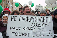 "Moscow, Russia, 04/02/2012..Satirical novelist Dmitry Bykov holds a poster reading ""Don't rock the boat - our rat is sick"",  as tens of thousands of demonstrators march in central Moscow and protest against election fraud and Prime Minister Vladimir Putin in temperatures of -20 centigrade. Organisers claimed an attendance of 130,000 despite the bitter cold."
