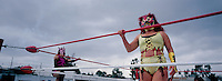 """Diabolica, a """"Luchadora"""" (female wrestler) growls at the crowd in Ecatepec, Estado de Mexico. Diabolica is what is known as a wrestler that is """"Ruda"""" (these are the badies) as opposed to """"Tecnico"""" who are the ones who follow the rules (goodies). Mexico, June 2004"""