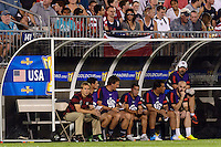 United States head coach Jurgen Klinsmann and his staff watch from the bench. The United States defeated Costa Rica 1-0 during a CONCACAF Gold Cup group B match at Rentschler Field in East Hartford, CT, on July 16, 2013.
