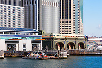 US, New York City. Lower Manhattan seen from the Staten Island ferry. Battery Maritime Building and Whitehall ferry terminals.