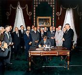 United States President John F. Kennedy signs the Limited Nuclear Test Ban Treaty in the White House Treaty Room on October 7, 1963. From left to right: William Hopkins, U.S. Senator Mike Mansfield (Democrat of Montana), John J. McCloy, Adrian S. Fisher, U.S. Senator John Pastore (Democrat of Rhode Island), W. Averell Harriman, U.S. Senator George Smathers (Democrat of Florida), U.S. Senator J.W. Fulbright (Democrat of Arkansas), U.S. Secretary of State Dean Rusk,  U.S. Senator George Aiken (Republican of Vermont), President Kennedy, U.S. Senator Hubert H. Humphrey (Democrat of Minnesota),  U.S. Senator Everett Dirksen (Republican of Illinois), William C. Foster, U.S. Senator Howard W. Cannon (Democrat of Nevada), U.S. Senator Leverett Saltonstall (Republican of Massachusetts), U.S. Senator Thomas H. Kuchel (Republican of California), U.S. Vice President Lyndon B. Johnson. White House, Treaty Room. .Credit: Robert Knudsen - White House via CNP