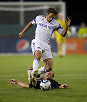 Kurt Morsink (6) of D.C. United tries to tackle the ball away from Josh Wolff (16) of the Kansas City Wizards at RFK Stadium in Washington, DC.  D.C. United defeated the Kansas City Wizards, 2-1.