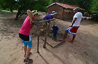 Pumping water from a hand-pump water well in Izozog, Santa Cruz, Bolivia