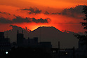 The sun set behind Mt Fuji as seen from Tokyo