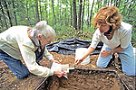 Margaret Biggs & Regina Salice Checking Color Of Soil Against Color Chart