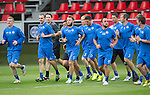 Spartak Trnava v St Johnstone...06.08.14  Europa League Qualifier 3rd Round<br /> Stevie May on a warm-up run with his team mates during training in the FC Vion Stadium<br /> Picture by Graeme Hart.<br /> Copyright Perthshire Picture Agency<br /> Tel: 01738 623350  Mobile: 07990 594431