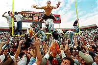 A jubilant Florida State fan dives off the goal post during post game festivities after the Seminoles defeated the Florida Gators 24-21 in Tallahassee Saturday, Nov. 30, 1996.  (AP Photo/Colin Hackley, Tampa Tribune)