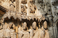 South Porch, Right Portal, Left Jambs. Cathedral of Chartres, France. Gothic statue of the four ?Confessors? important intellectual and spiritual leaders, most of whom lived during the early centuries of the Church. They stand on historiated socles- there are canopies offer their heads with architectural motifs. From left to right they are .1) Laumer (also called Lomer or Laudomarus), a local saint who was founder and Abbot of the nearby monastery of Corbion in the 6th century..2) Pope Leo I, an influential early Pope.3) a figure that is either Ambrose or Thomas Becket .4) Nicholas, bishop of Myra (two of his miracles appear in the tympanum).The figure of Laumer was added after the rest of the portal was created. . A UNESCO World Heritage Site.