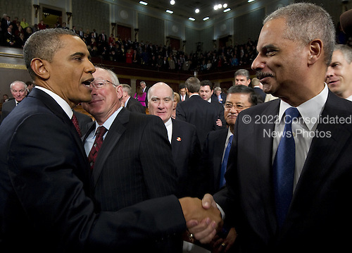 United States President Barack Obama greets U.S. Attorney General Eric Holder folllowing his State of the Union address in front of a joint session of Congress on Tuesday, January 24, 2012 on Capitol Hill in Washington, DC. .Credit: Saul Loeb / Pool via CNP