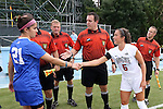 22 August 2014: Ohio State captain Elly Gruber (5) and Duke captain Gilda Doria (21) shake hands as referee Ryan Cigich (center) waits for the coin flip. The Duke University Blue Devils played The Ohio State University Buckeyes at Fetzer Field in Chapel Hill, NC in a 2014 NCAA Division I Women's Soccer match. Ohio State won the game 1-0.