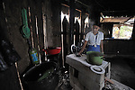 A woman cooks in her kitchen in Victoria 20 de enero, a village of former Guatemalan refugees in Mexico who returned home as a group in 1993, while the country's bloody civil war still raged.