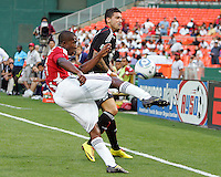 Santino Quaranta #25 of D.C. United reacts to a clearance by Michael Lahoud #11 of Chivas USA during an MLS match at RFK Stadium, on May 29 2010 in Washington DC. United won 3-2.